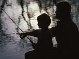Silhouette of Father and Five-year-old Son Fishing