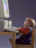 Baby Sitting at Desk Using Computer