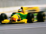 Yellow Race Car in Motion Photographic Print