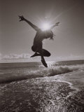 Silhouette of Dancer Jumping Over Atlantic Ocean Photographic Print