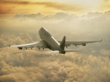 Jumbo Jet Above Clouds at 35,000 Feet Photographic Print
