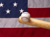 Bat Hitting Baseball Against Flag