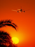 Airplane Flying Over Sunrise Photographic Print