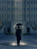 Man with Umbrella Under a Regional Rain