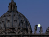 Buy A Full Moon Rises over the Dome of St. Peters Basilica at AllPosters.com
