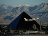 A Jet Flies Past the Luxor Hotel, the Worlds Fourth Largest Pyramid