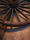 Close-up of Wooden Wagon Wheel Lit by Setting Sun