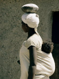 A Xhosa Woman Balances a Container on Her Head and a Baby on Her Back Photographic Print