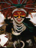 A Tribal Woman Decorated with Beads, Feathers, and Cowries