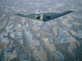 A B-2 Stealth Bomber Flies Above the Patterned Terrain of Southwestern Nebraska
