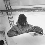 Sail Maker Howard Boston Sitting in His Craft at Northwest Ice Yacht Regatta