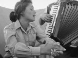 Young Israeli Woman Singing While Accompanied by Someone Playing an Accordion