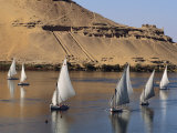 Feluccas on the Nile Sail Past the Tombs of Qubbat Al Hawa at Aswan