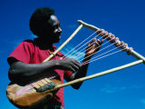 Man Playing Local Stringed Instrument at Kebirigo, Kenya