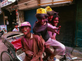 Group on Rickshaw Celebrating Holi Festival, Delhi, India