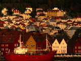 Fishing Vessel Moored in Front of Wooden Buildings on the Bryggen Waterfront, Bergen, Norway