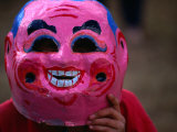 Boy Wearing Colourful Mask at Tet Nguyen Dan Celebrating Lunar New Year Holiday, Da Lat, Vietnam