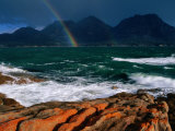 Rainbow Dipping into Coles Bay During Stormy Weather, Freycinet National Park, Tasmania, Australia