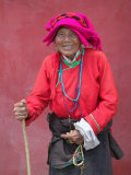 Elderly Tibetan Woman with Red Wall, Tagong, Sichuan, China