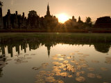 Sukhothai Ruins and Sunset Reflected in Lotus Pond, Thailand
