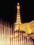Paris Hotel and Casino's Eiffel Tower with the Bellagio Water Fountain Show, Las Vegas, Nevada, USA