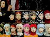 Arab Woman Buys an Islamic Head Dress in Preparation for the Muslim Holy Fasting Month of Ramadan