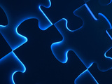Black Puzzle with Blue Light Shining Through the Cracks