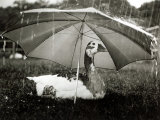 A Goose Takes Cover from the Heavy Rainfall Underneath an Umbrella, Dorset, October 1968