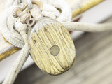 Wooden Pulley and Rope on Edge of Boat