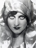 Close-Up of the Actress Joan Crawford Wearing a Lame Cap That Accents the Beauty of Her Eyes Photographic Print