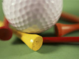 Close-up of a Golf Ball and Tees