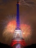 Fireworks Illuminate the Eiffel Tower Fireworks at the Brandenburg Gate in Berlin, Germany Commemorating the Fall of the Berlin Wall Three Frames of Lightning Hitting Cedar Hills Area Fireworks Flash over Sydney Harbor During New Year Celebrations Fireworks Display Night Sky Filled with Fireworks