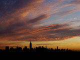 The Empire State Building is the Focal Point of the New York Skyline at Sunrise