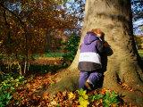 Boy Playing Hide-And-Seek in Frederiksberg, Copenhagen, Denmark