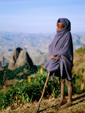 Shepherd Boy with Simien Mountains Background, Simien Mountains National Park, Ethiopia
