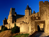 Tourists Enter Medieval Walled City at Sundown Via Porte D'Aude, Carcassonne, France