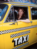 Actress Marilu Henner Sitting in Taxi Cab to Promote Reruns of Her Television Series Taxi