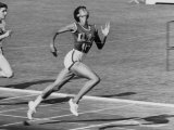 Wilma Rudolph, Across the Finish Line to Win One of Her 3 Gold Medals at the 1960 Summer Olympics Premium Photographic Print