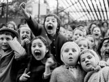 Wide Range of Facial Expressions on Children at Puppet Show the Moment the Dragon is Slain Photographic Print