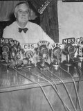 President Franklin D. Roosevelt Sitting Behind a Bank of Microphones from Various Radio Networks