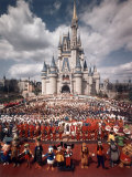 Walt Disney Characters and Park Staff Posing En Masse in Front of Cinderella's Castle