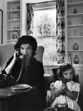 Jackie Kennedy, Wife of Senator John Kennedy, Talking on the Telephone as her daughter mimics her