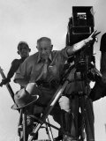 Cecil B. de Mille on Camera Stand in Desert While Directing Scenes from