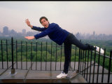 Comedian Jerry Seinfeld Acting Silly on His Apartment Building Rooftop Overlooking Central Park