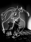 Multiple Exposure of Artist Pablo Picasso Using Flashlight to Make Light Drawing of a Figure