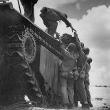 American Soldiers Wounded During Landing on Guam Being Loaded Onto Amphibious Truck for Evacuation
