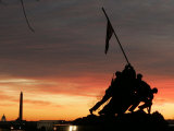 With Washington in the Background, the Sun Rises Behind the Silhouetted Iwo Jima Memorial, Center