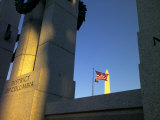 The World War II Memorial, a U.S. Flag and the Washington Monument
