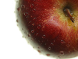 Close-up of a Juicy Red Apple with Shiny Water Droplets