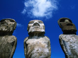 Traditional Moai Carved from Soft Volcanic Rock with Clouds Above, Ahu Tongariki, Chile